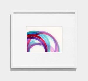 framed abstract painting of purple, pink, blue interlocking circles