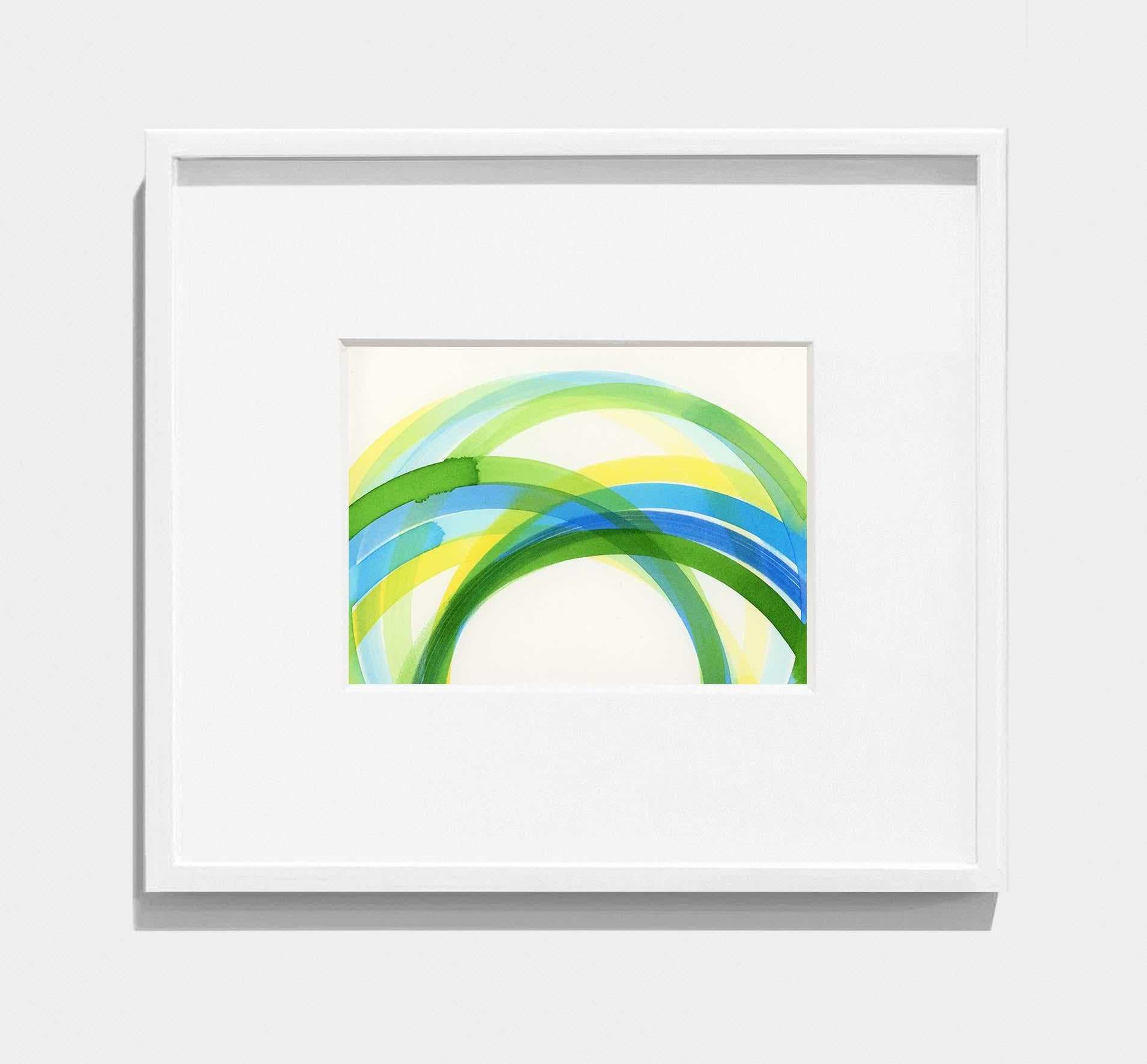 framed abstract painting of interlocking yellow, green, blue circles