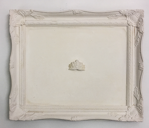 mixed media plaster art with vintage frame