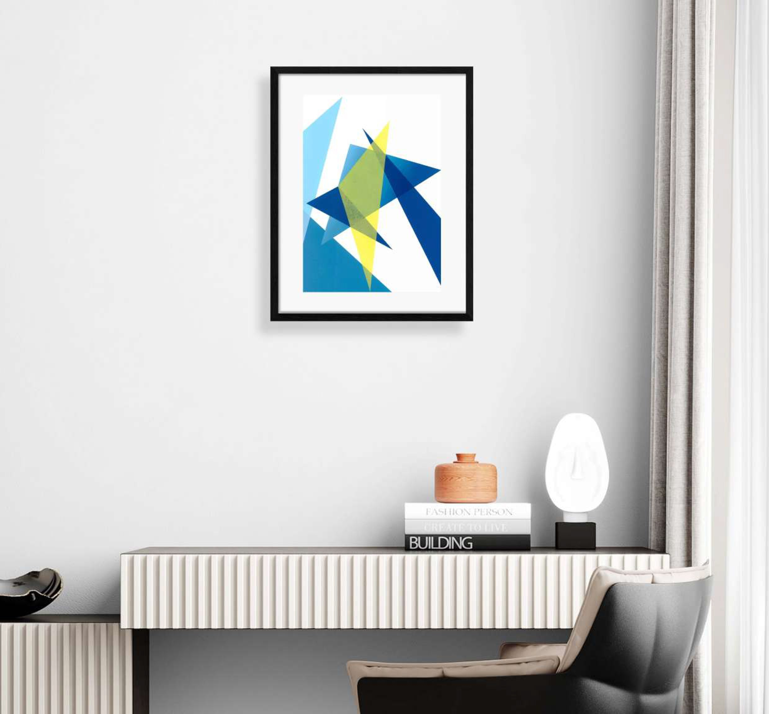 interior display of framed blue and yellow geometric shaped print
