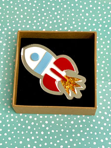 collectible acrylic rocket brooch
