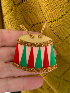 gorgeous acrylic christmas drum brooch in red, green, soft pink and gold colours