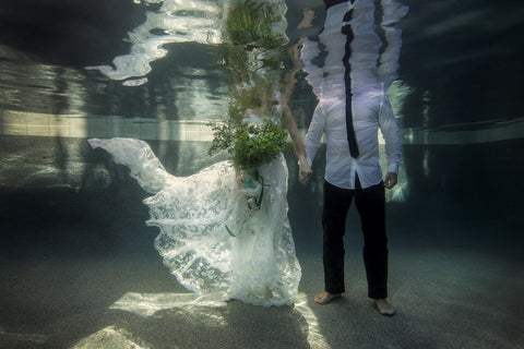 Wedding Dress Underwater Holding Hands