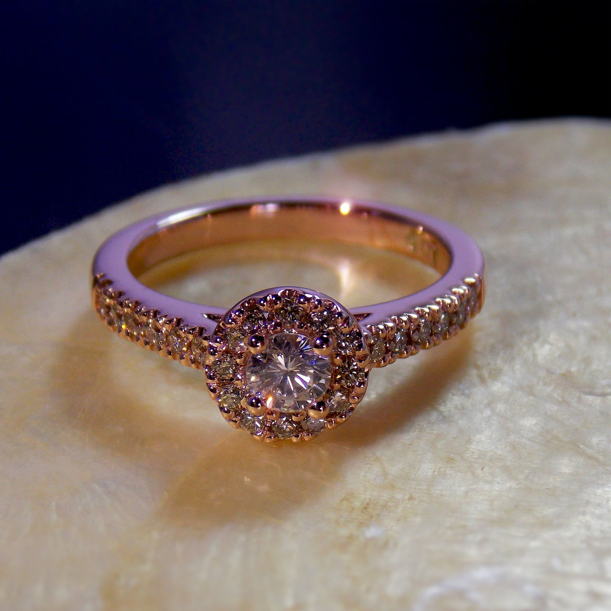 9K rose gold and diamond halo ring