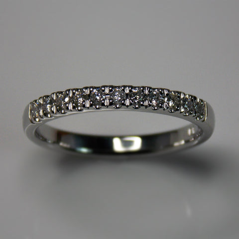 White gold and diamond half eternity band