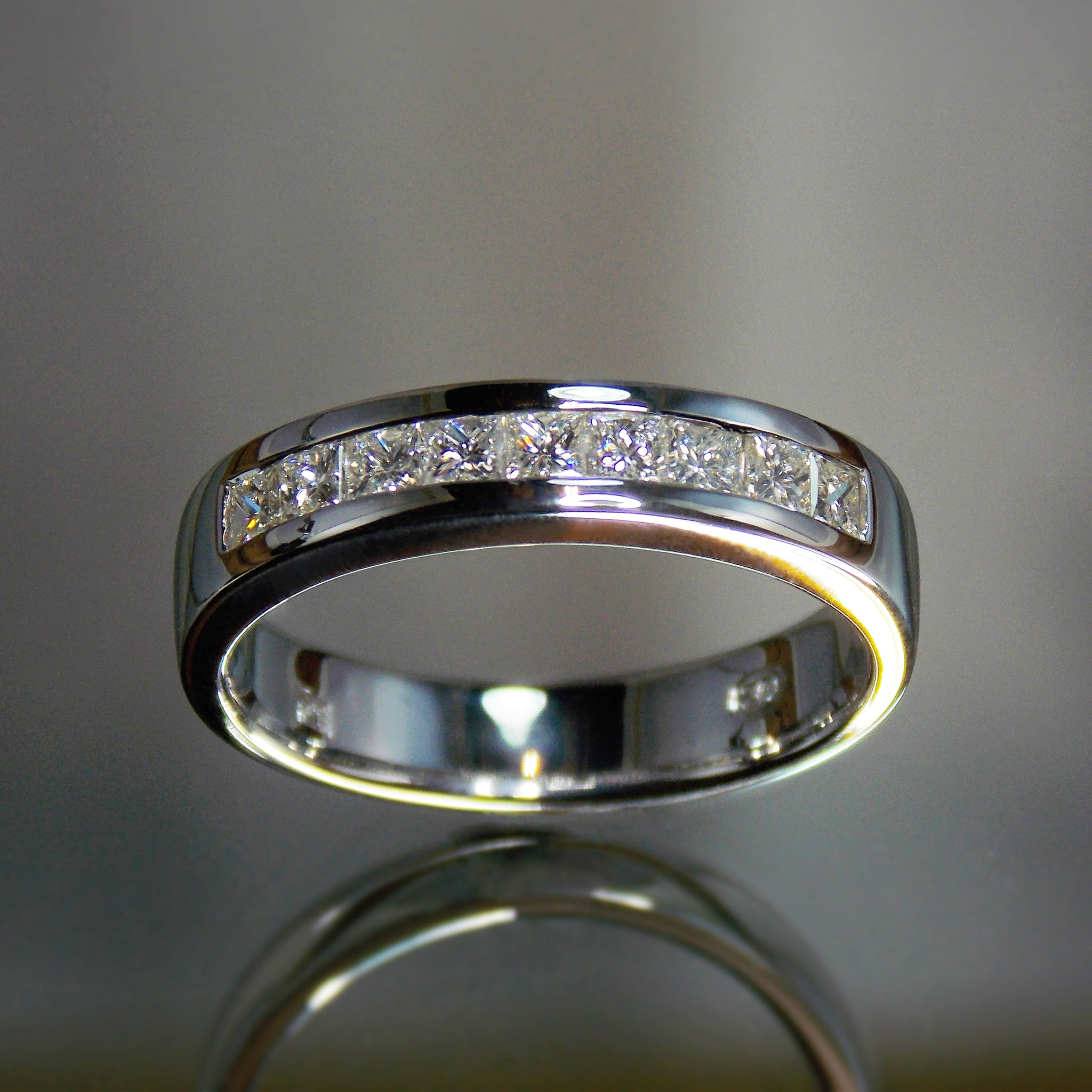 Princess cut diamond channel band in platinum