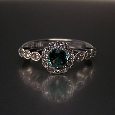 Vintage 18K white gold engagement ring set with green tourmaline & diamonds
