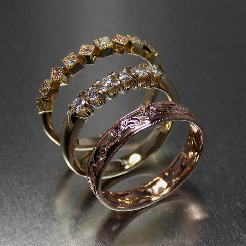 Yellow & rose gold stack rings set with white and pink diamonds