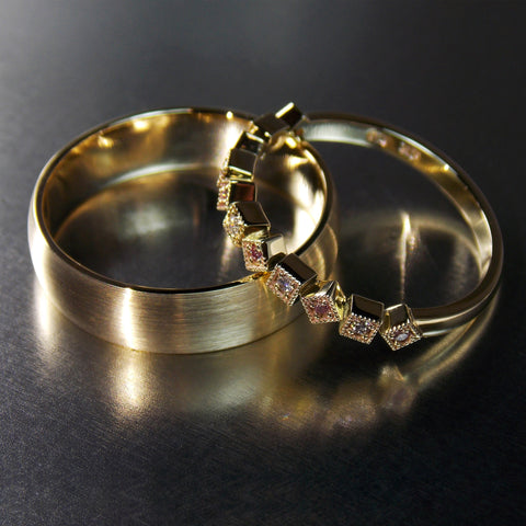 9K yellow gold Men's and ladies wedding bands. Ladies band set with white and pink diamonds