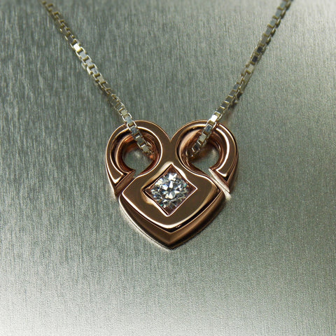 Open heart solitaire diamond pendant in 18K rose gold