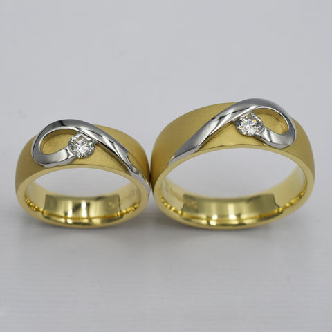 Yellow gold and platinum men's and ladies matching heart bands set with diamonds