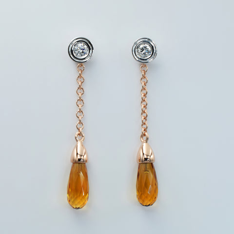 White and rose gold hanging earrings. Diamond studs with briolette cut citrines
