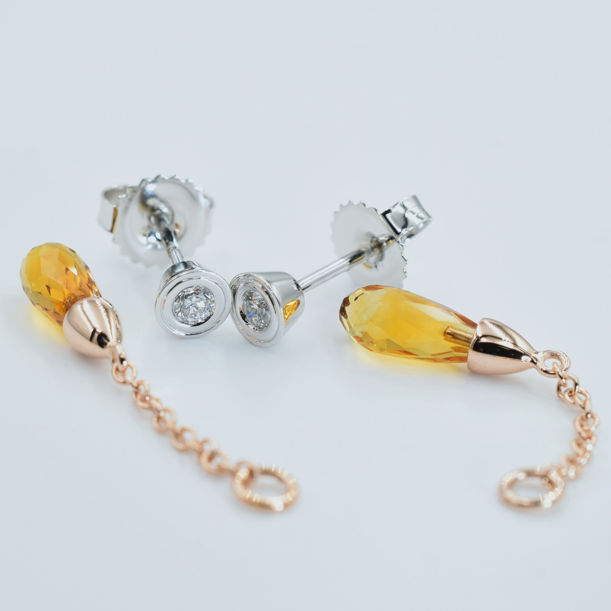 White and rose gold earrings. Wear as simplistic diamond studs or with rose gold briolette cut citrine attachment