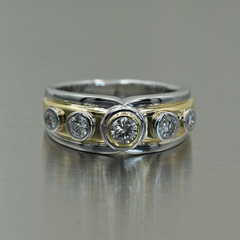 Yellow and white gold tube set 5 diamond ring