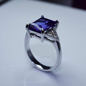 18K white gold trilogy with emerald cut tanzanite & diamonds