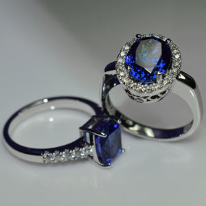 Oval tanzanite halo and cushion solitaire in 18K white gold