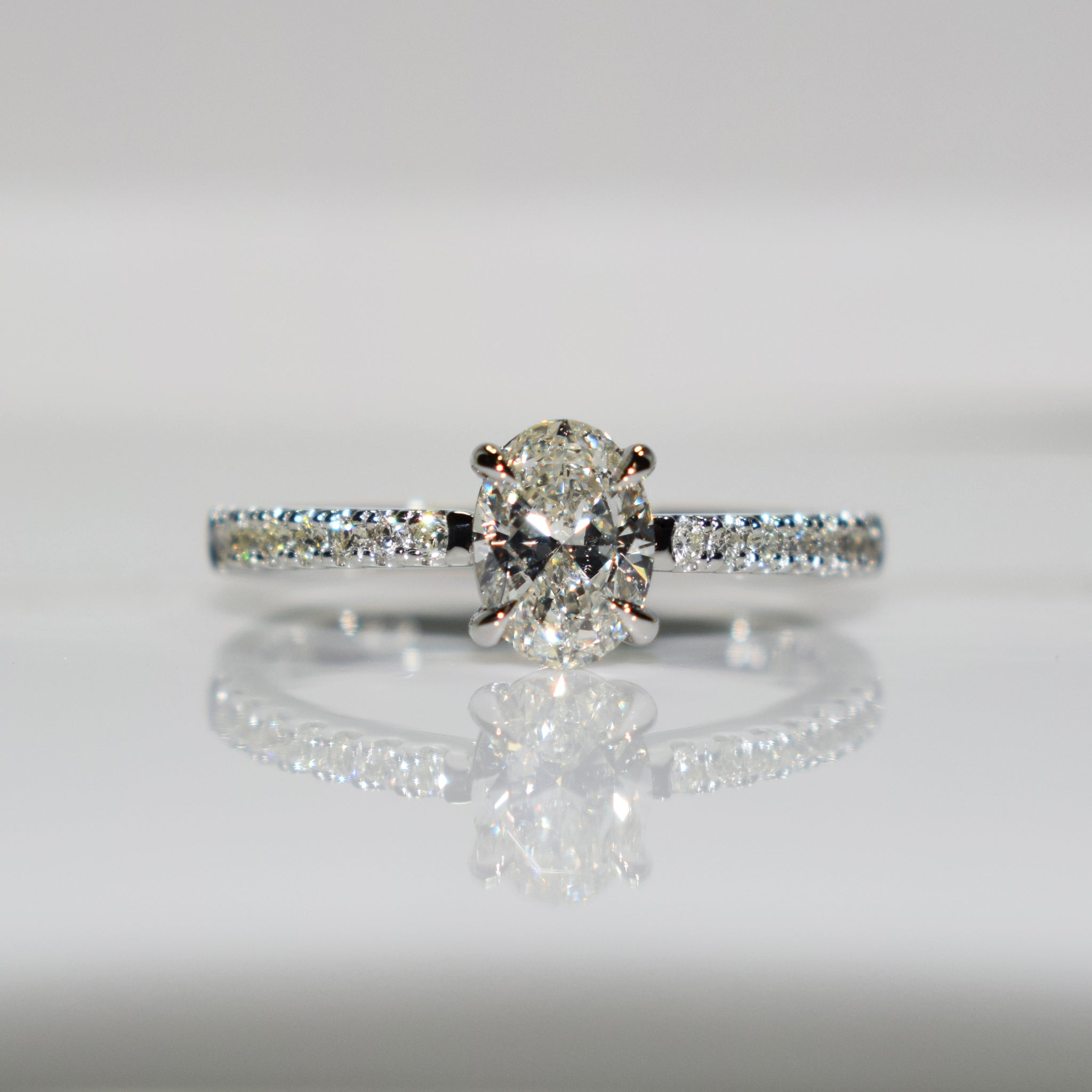 Oval diamond solitaire set with eagle claws in platinum