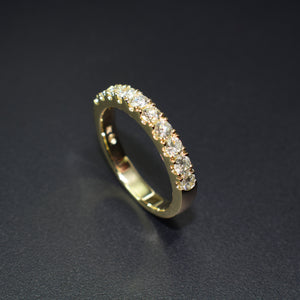Yellow gold and diamond half eternity band