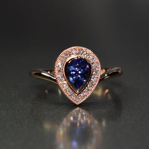 9K rose gold pear shape halo set with tanzanite & diamonds