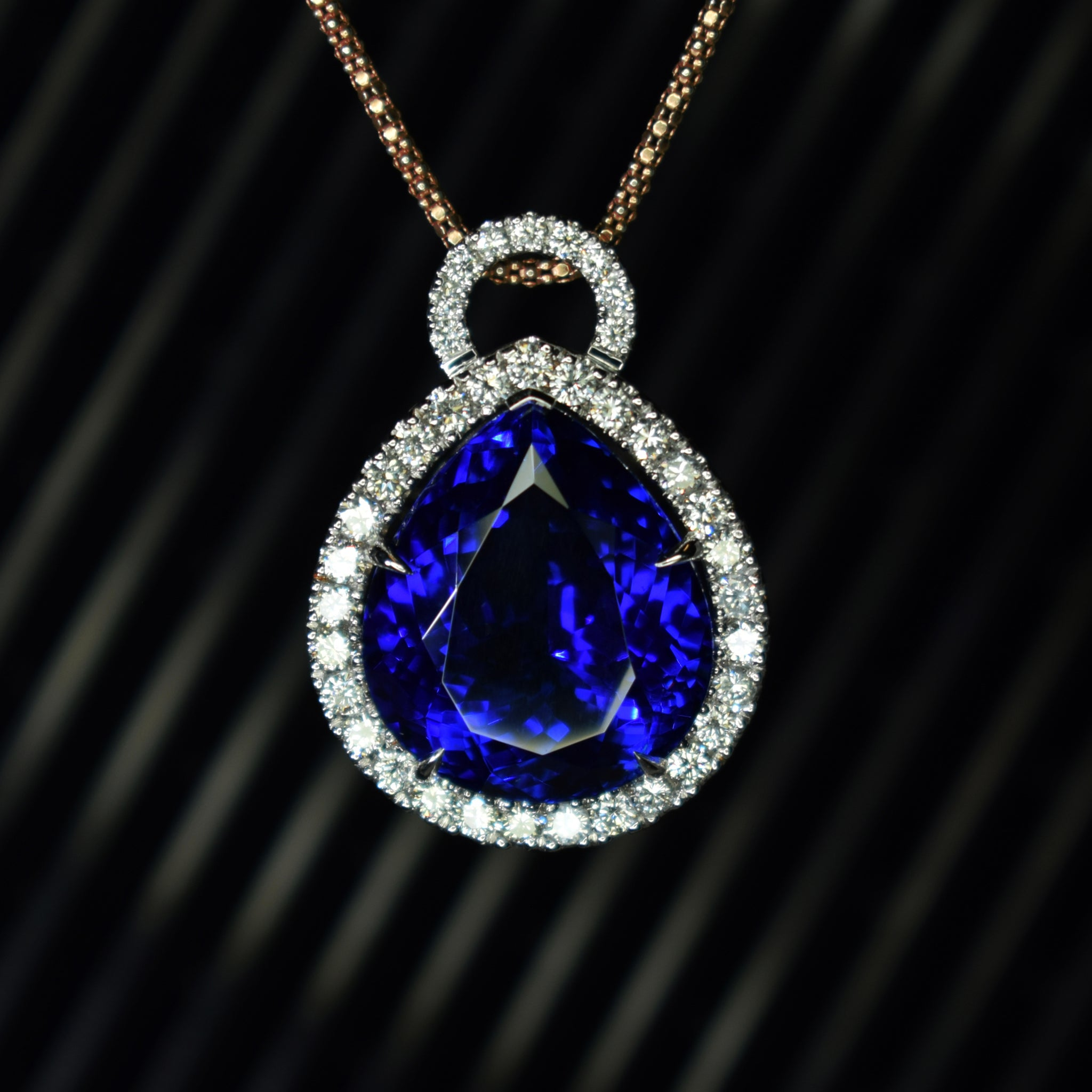 21ct pear shape tanzanite with diamond halo pendant