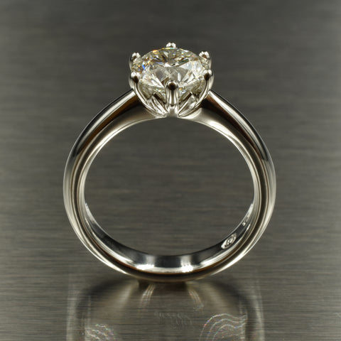 Diamond and platinum floral six-claw solitaire