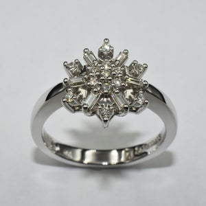 9K white gold snowflake inspired ring, set with round and baguette diamonds