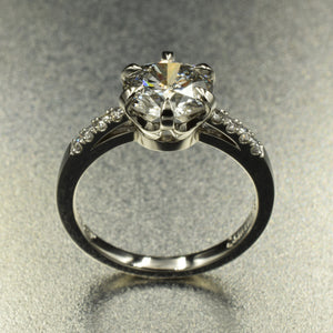 Eagle claw, crown setting solitaire. Diamonds in platinum