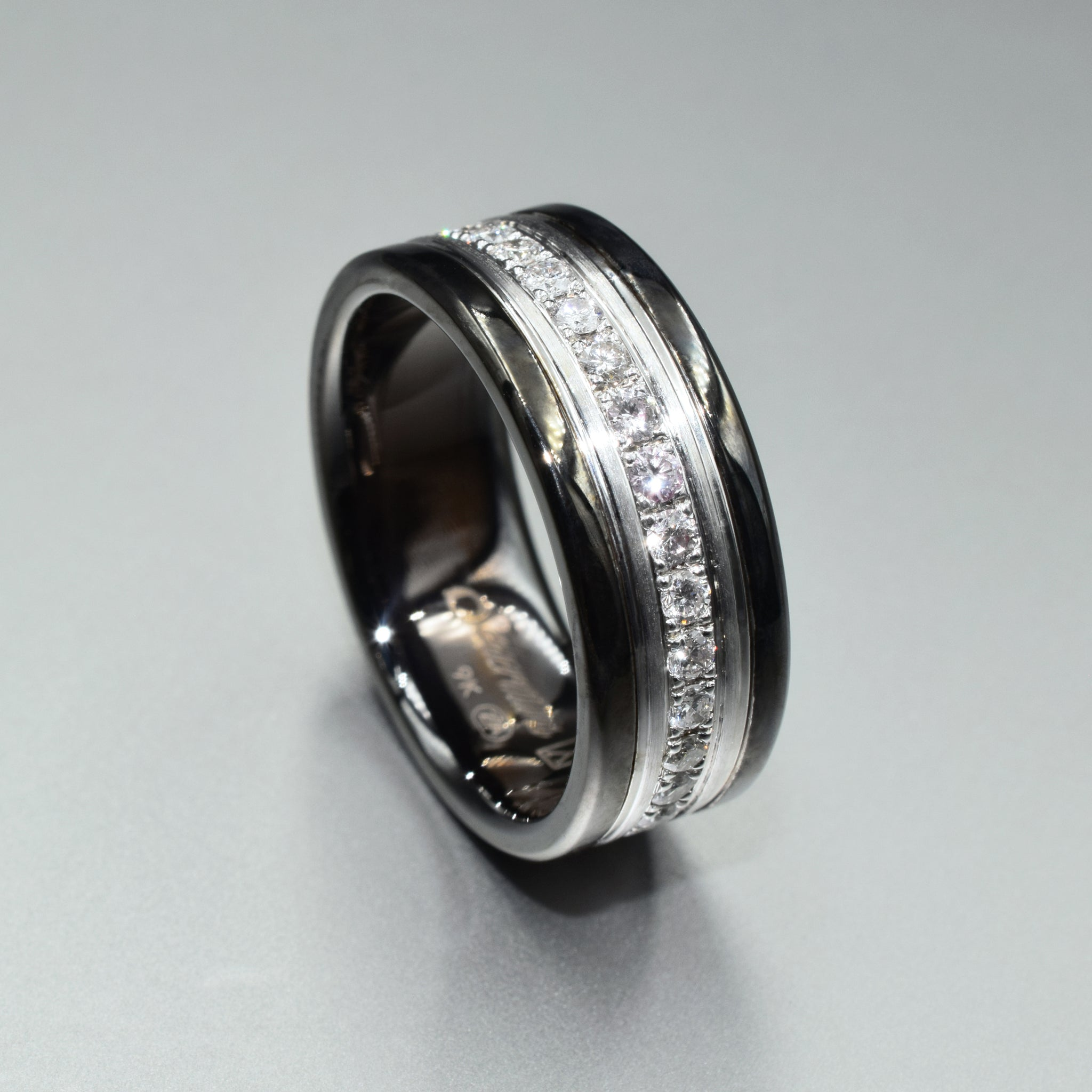Blackened white gold and diamond eternity pave band