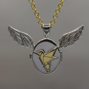 White and yellow gold winged origami locket