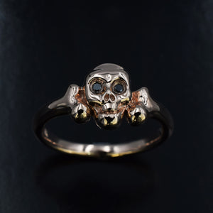 Rose gold skull ring with black diamond eyes