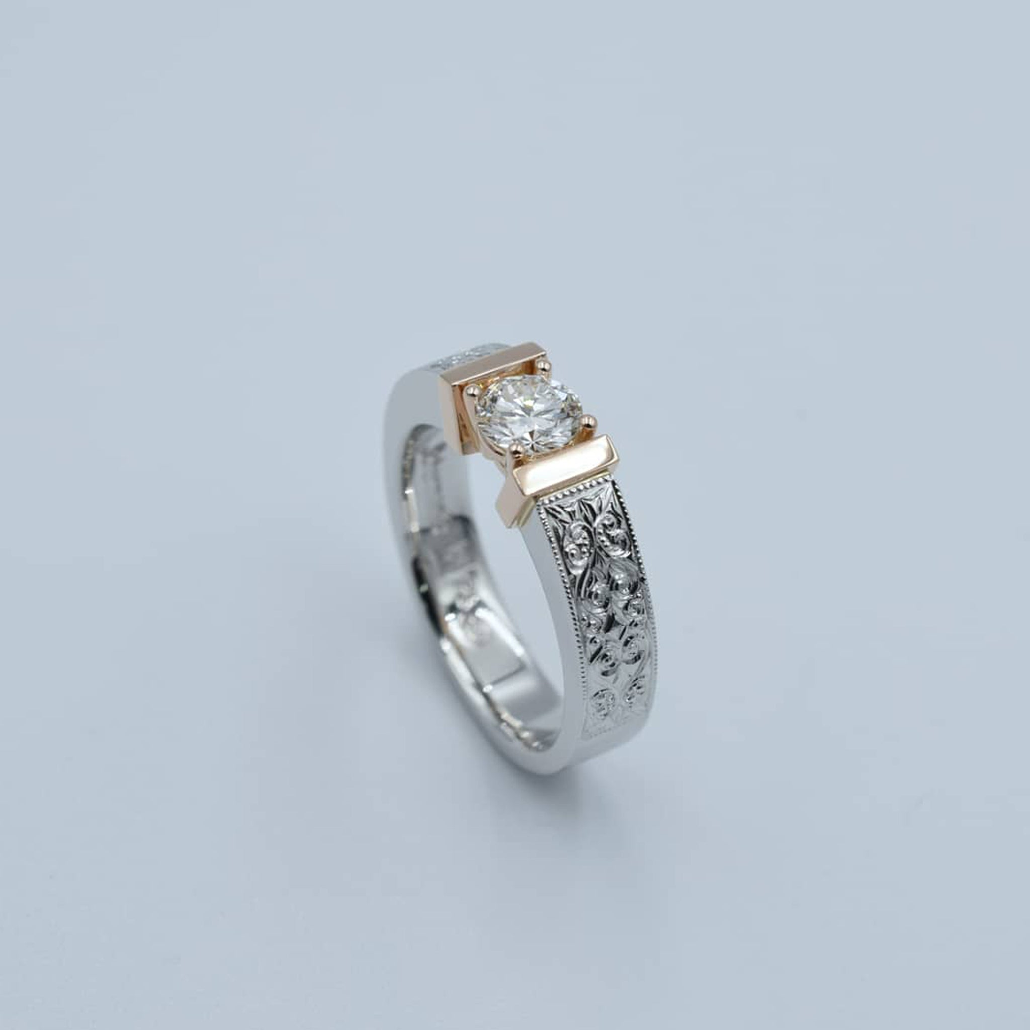 Platinum & 18K rose gold diamond solitaire with fine hand-engraved side detail