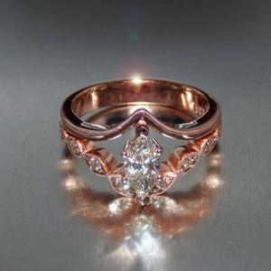 Marquise cut diamond engagement ring set in 9K rose gold