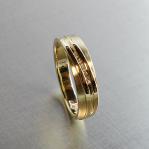 Yellow gold and diamond crossover band