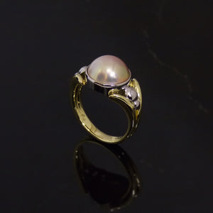Platinum and yellow gold mabe pearl dress ring