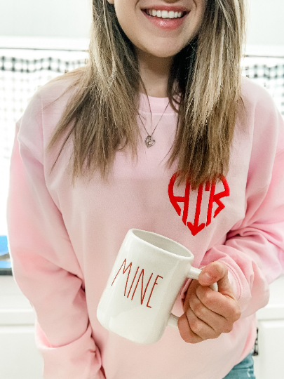 light pink gildan sweatshirt with heart embroidered monogram