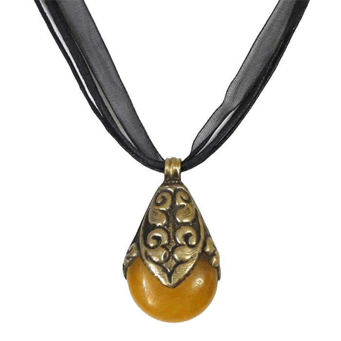 "Amulet made of amber and repurposed coin silver displayed on a black organza ribbon and cotton cord about 17"" long."