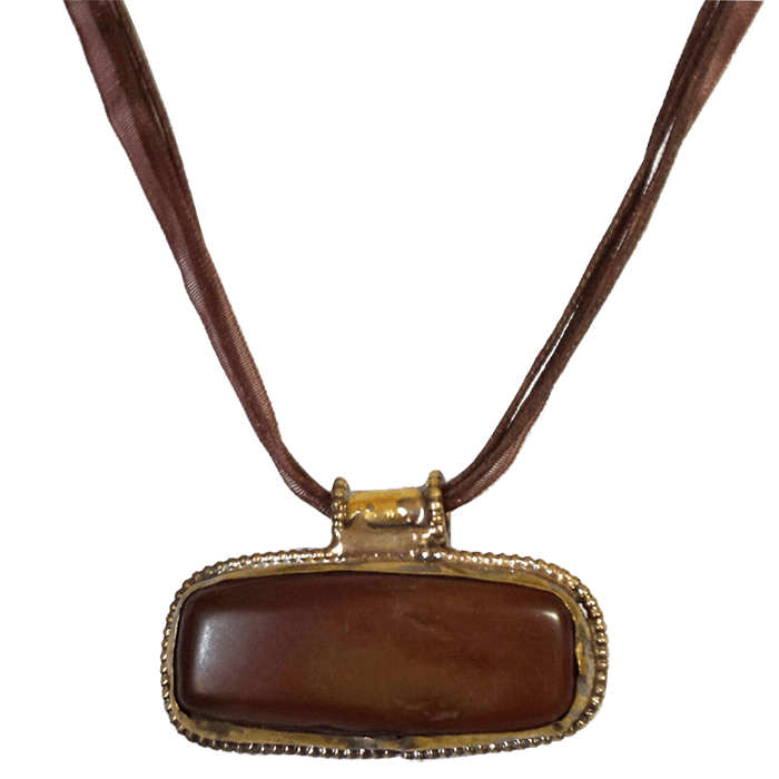 "Brownish-red mineral in a setting of brass and copper between 1"" – 2.25"". The pendant comes on a brown organza ribbon and cotton cord and measures approximately 17"" long."