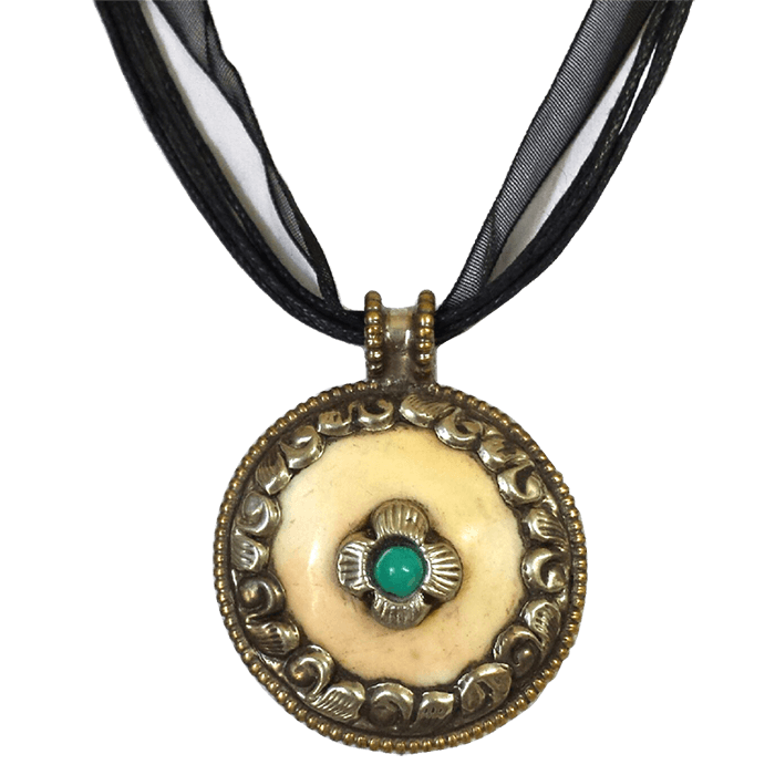 "Naga shell pendant encased in brass with colorful bead inlay (1.25"") Comes on a black organza ribbon and cotton cord about 17"" long."