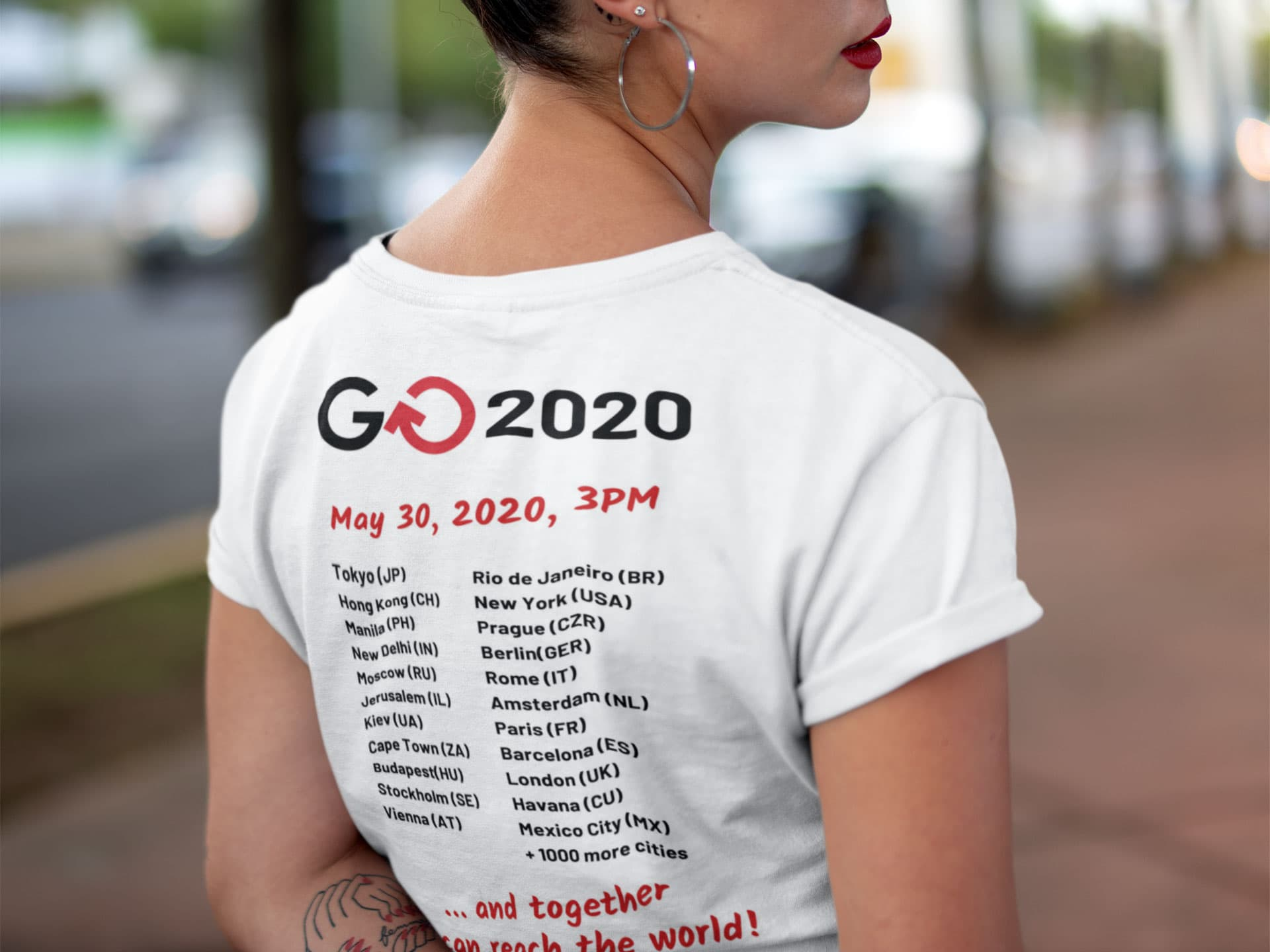 Woman wearing Global Outreach 2020 Adult T-Shirt