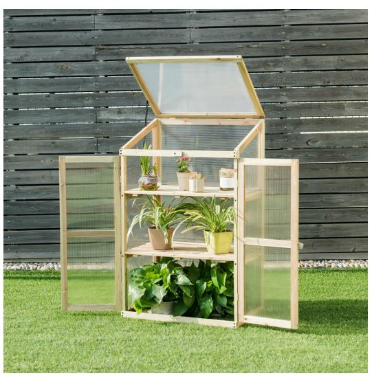 Three tier cold frame greenhouse displayed on front lawn with all doors and lids open to the sun