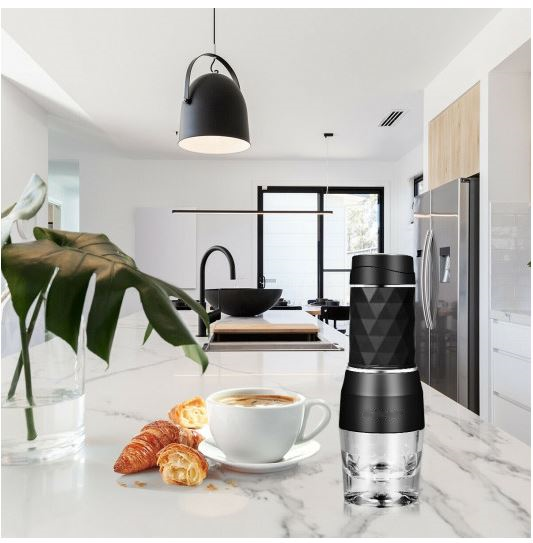 Portable coffee maker on counter with kitchen in the background