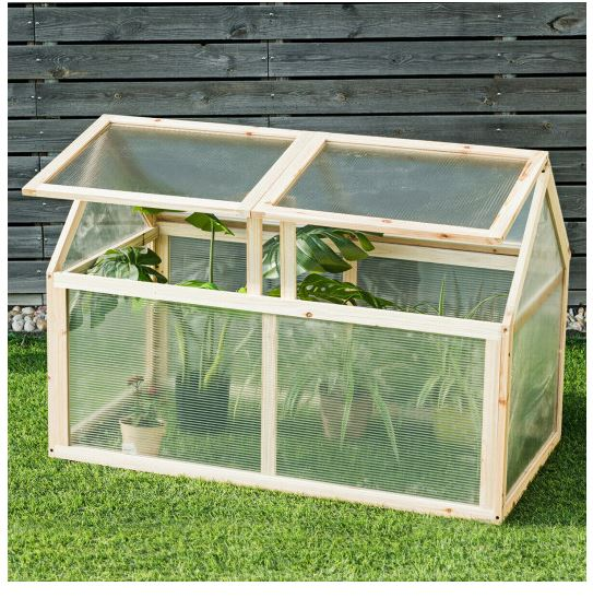 Greenhouse on lawn with both top panels open