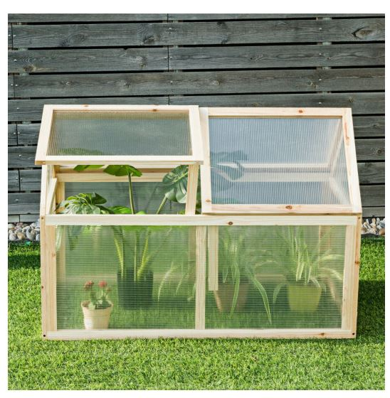 Greenhouse sits on lawn with one roof panel open to display plants inside