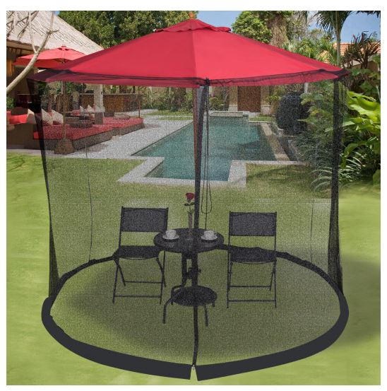 Mosquito net on umbrella outside next to a pool