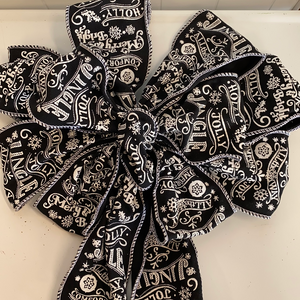 Black holiday bow with white Christmas sayings
