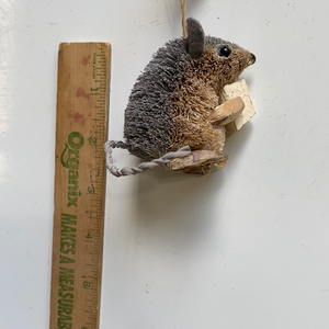 Mouse chewing on wood holiday ornament