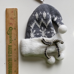Grey Holiday winter hat with fur lining ornament