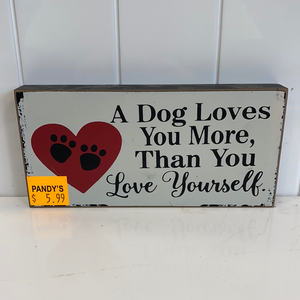 Sign: A Dog Loves...