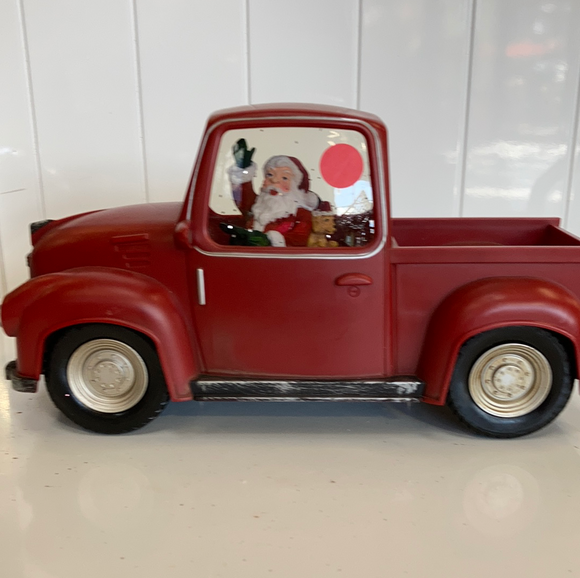 Holiday Santa Claus in Red Pickup Truck