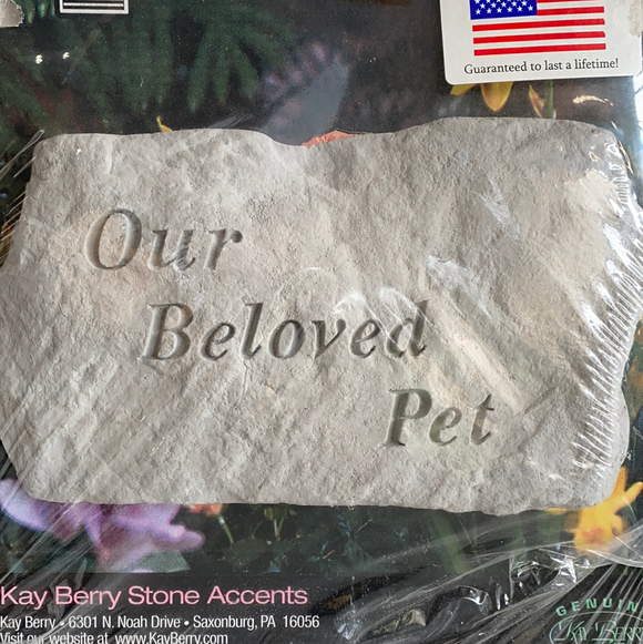 """Our beloved pet"" garden accent"